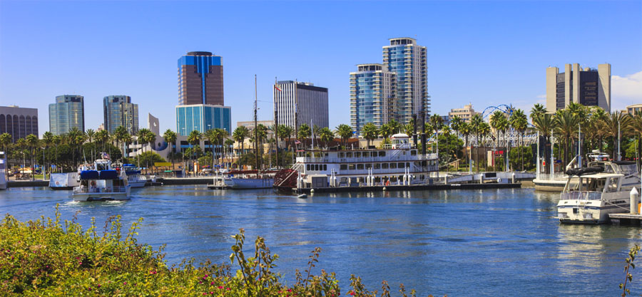 Rainbow Harbor at Long Beach Marina with city skyline, California